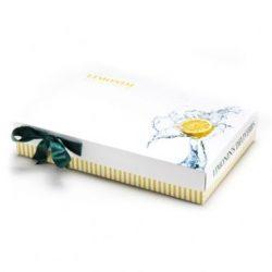 קופסה נמוכה עם בסיס פסים צהובים והדפס לימון על המכסה